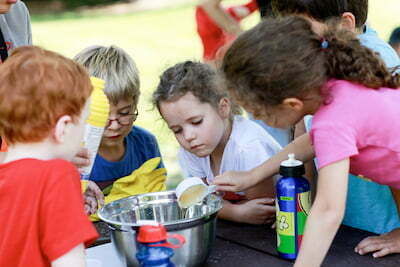 Campers Fascinated by Chemistry Experiment at Summer Camp Ancaster